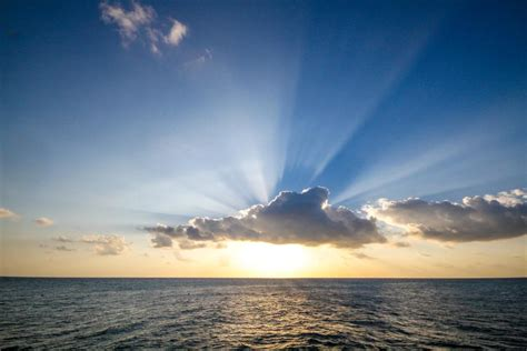Picture of Sun Setting Over Ocean - Free Stock Photo