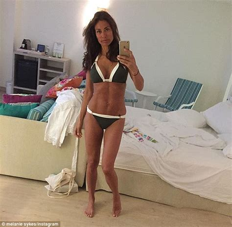 Melanie Sykes shows off her washboard abs on Instagram in