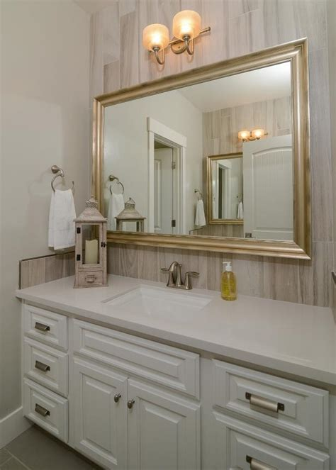 Guest Bathroom Features Wood-Look Tile Accent Wall | HGTV