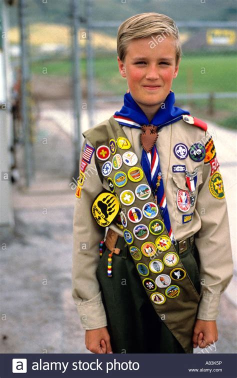 Boy scout in uniform with sash of badges Stock Photo - Alamy