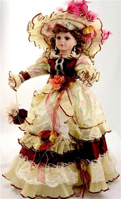 COLLECTIBLE PORCELAIN VICTORIAN PRINCESS DOLL RED AND GOLD