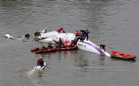 Image: Rescuers carry out a rescue operation after a